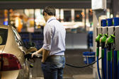Man fueling his car at the gas station — Stock Photo