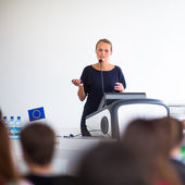 Business woman giving a presentation — Stock Photo