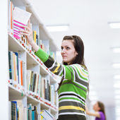 Female student searching for books — Stock Photo