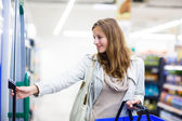 Woman shopping in a grocery store,supermarket — Stock Photo