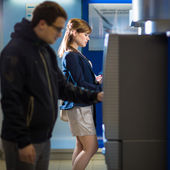 Woman withdrawing money at ATM — Stock Photo
