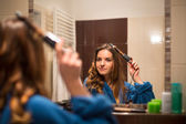 Woman curling her hair — Stok fotoğraf