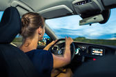 Woman driving a car at dusk — Foto Stock