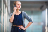 Woman calling on a smartphone — Stock Photo