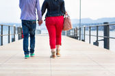 Quite disproportionate young couple walking — Stock Photo