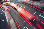 Motion blurred city road traffic — ストック写真