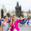 Two female tourists walking along the Charles Bridge — Stock Photo #46715291