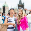 Two female tourists walking along the Charles Bridge — Stock Photo #46715299