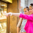 Women window shopping in a city — Stock Photo #46715333