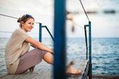 Woman at the seacoast — Stock Photo