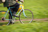 Motion blurred bicycle — Photo