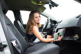 Female driver playing music in the car — Foto Stock