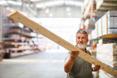Man buying construction wood in a  DIY store — Stock Photo