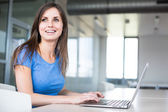 Female student with laptop and books — Stock Photo