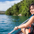 Woman on a canoe on a lake — Stock Photo #47258925