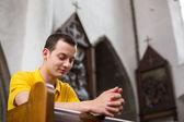 Man praying in a church — Stock Photo