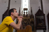 Man praying in a church — Stock Photo