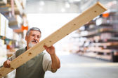 Man buying construction wood — Stock Photo