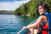 Woman on a canoe on a lake — Stock Photo