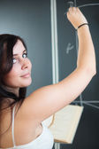College student drawing on the chalkboard — Stock Photo