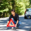 Young man with his car broken down — Stock Photo #49030629