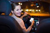 Woman using her smart phone at car — Stock Photo