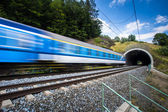 Fast train passing through a tunnel — Stock Photo