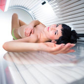 Woman  in a modern solarium — Stock Photo