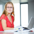Female student with books and laptop — Stock Photo