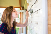 Woman checking her mailbox — Foto Stock
