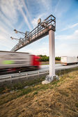 Truck passing through a toll gate — Stock Photo