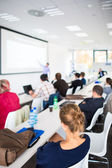 People at presentation in meeting room — Stock Photo