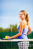 Young tennis player  on  a court — Stock Photo