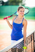 Pretty young tennis player — Stock Photo
