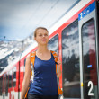 Woman traveling by train — Stock Photo #49687143