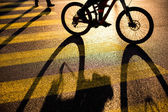 Biker or Cyclist on a crossing in a city — Stock Photo