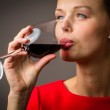Woman having a glass of red wine — Stock Photo #49976483