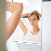 Woman in front of her bathroom — Foto de Stock