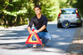 Man with his car broken down by the roadside — Stock Photo