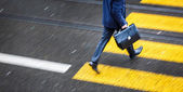 Man rushing over a road crossing — Stock Photo