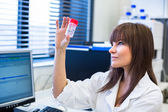 Portrait of a female researcher carrying out research — Stock Photo