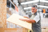 Man buying construction wood — Foto Stock