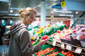 Woman shopping for fruits and vegetables in produc — Stock Photo