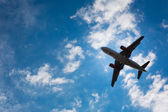 Dark silhouette of an airplane — Stock Photo