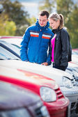 Young couple choosing car — Stock Photo