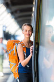 Woman in a trainstation, boarding a train — Stock Photo