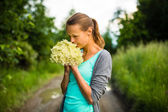 Woman picking elderflower — Stock Photo