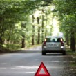 Broken down car with warning triangle behind it waiting for assi — Stock Photo #7416158