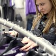 Pretty teenager shopping for clothes in a boutique/fashion shop/ — Stock Photo #7420178