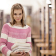 Pretty female college student in a llibrary — Stock Photo #7422562